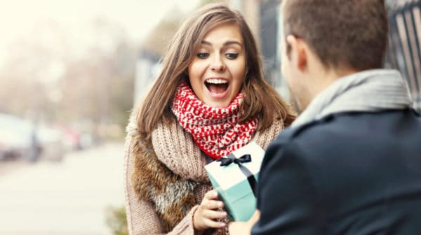 Featured | Young couple with present in the park | How Many Ways Can You Say Happy Birthday to a Techie? | Happy Birthday Techie