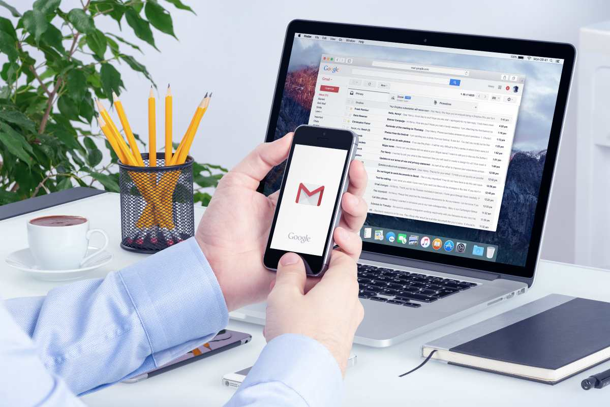 person using gmail on phone and computer | Sign Up For Gmail | A Comprehensive New User Guide | sign up for Gmail | gmail new account