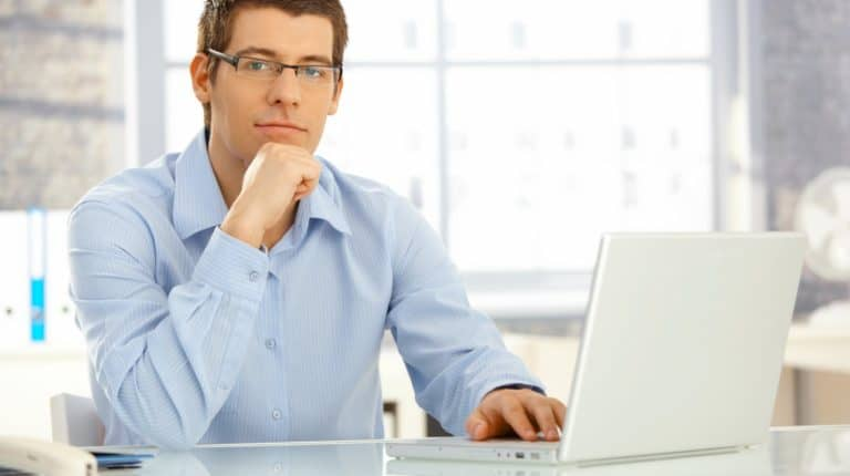 young man using his laptop   How To Delete a Skype Account in Quick Steps   how to delete skype account   Featured