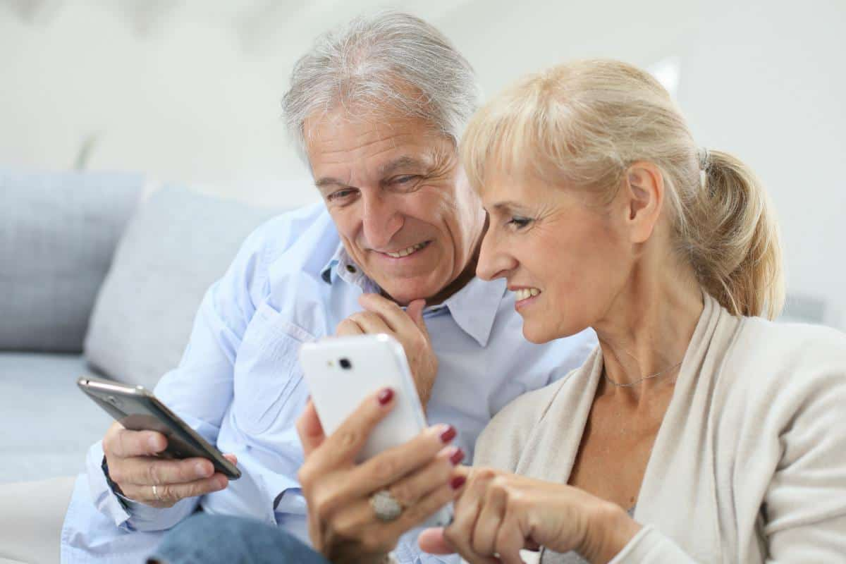 senior couple using smartphones | Sign Up For Gmail | A Comprehensive New User Guide | sign up for Gmail | email account