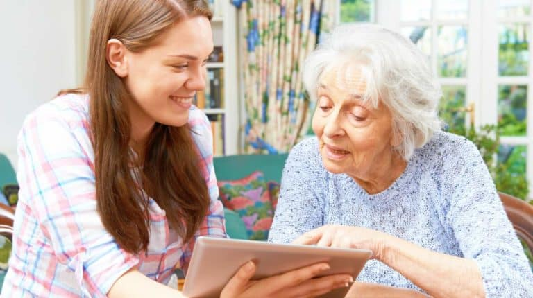 teenage granddaughter showing grandmother how use the tablet   How To Explain Technology To Your Parents   explain technology   technology today   Featured
