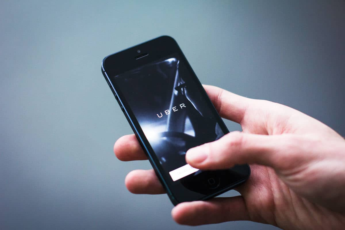 Uber app on screen   Download These Rideshare Apps Today
