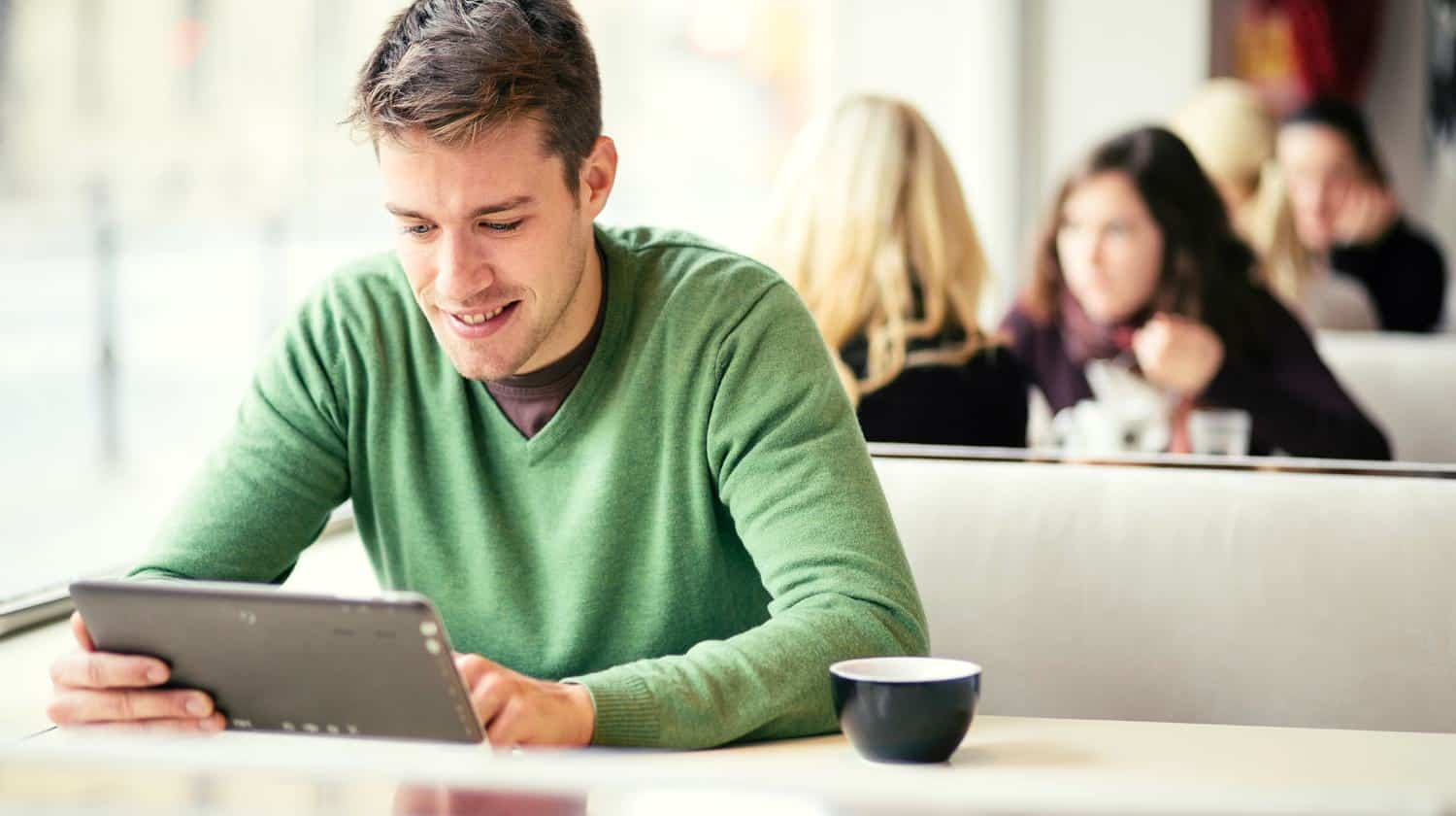 young man with his tablet | Feature | Gmail: How To Change Your Password | gmail | password | change