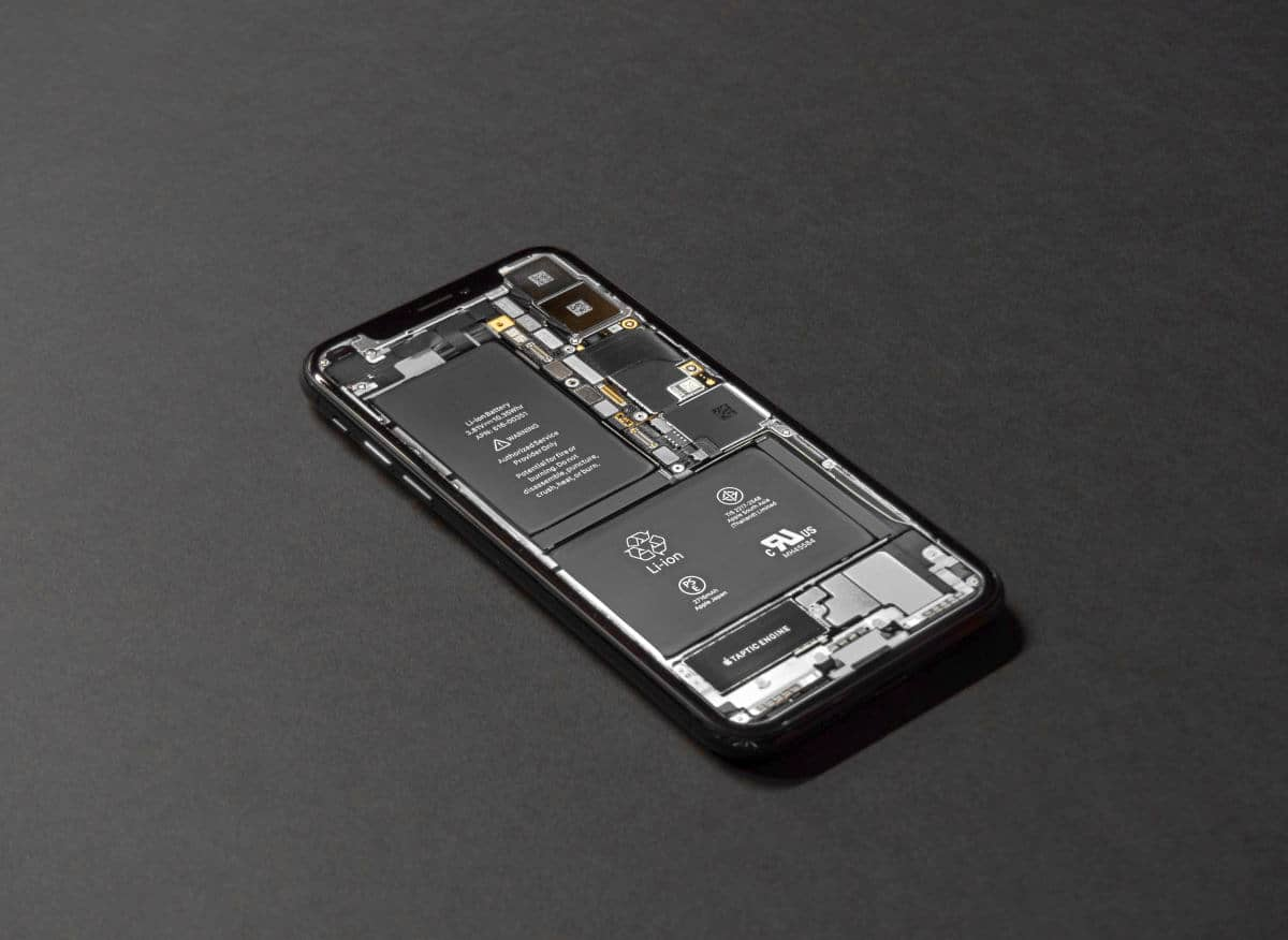 Smartphone on tablet | iPhone Battery Replacement Options | iPhone Battery Replacement Guide: When To Replace It And When To Buy New