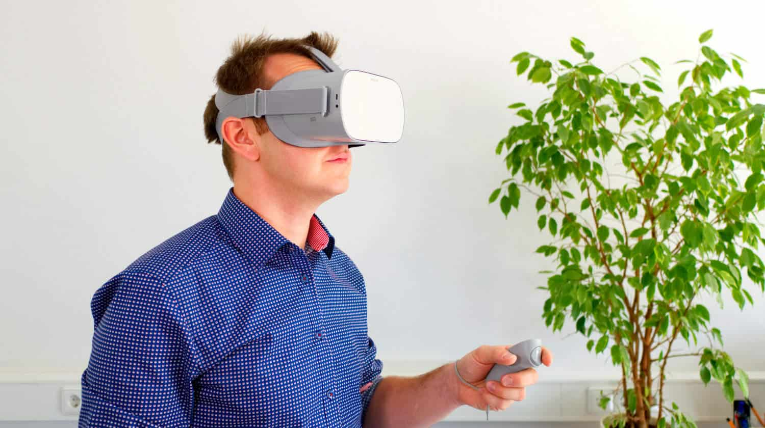Featured | Man wearing VR glasses | What Is VR? How Virtual Reality Will Change The Future | virtual reality headset | playstation vr headset | virtual reality experience