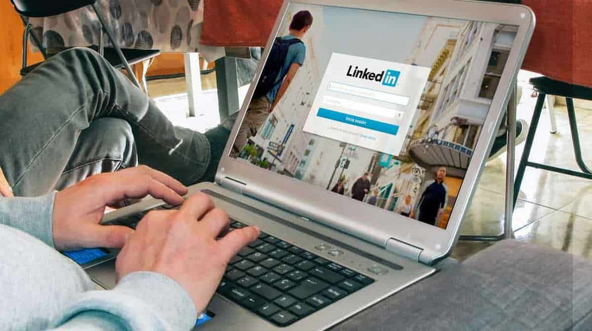 Man using laptop | What Is LinkedIn? How To Use This Powerful Social Tool | Simple LinkedIn Guide