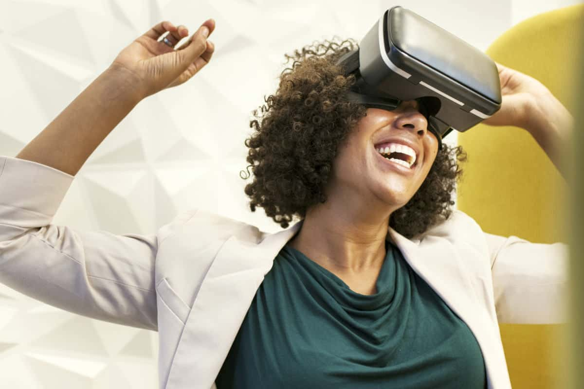 Woman using VR | AR vs VR: How Do Virtual And Augmented Reality Differ | What Is the Difference Between AR and VR? | augmented reality