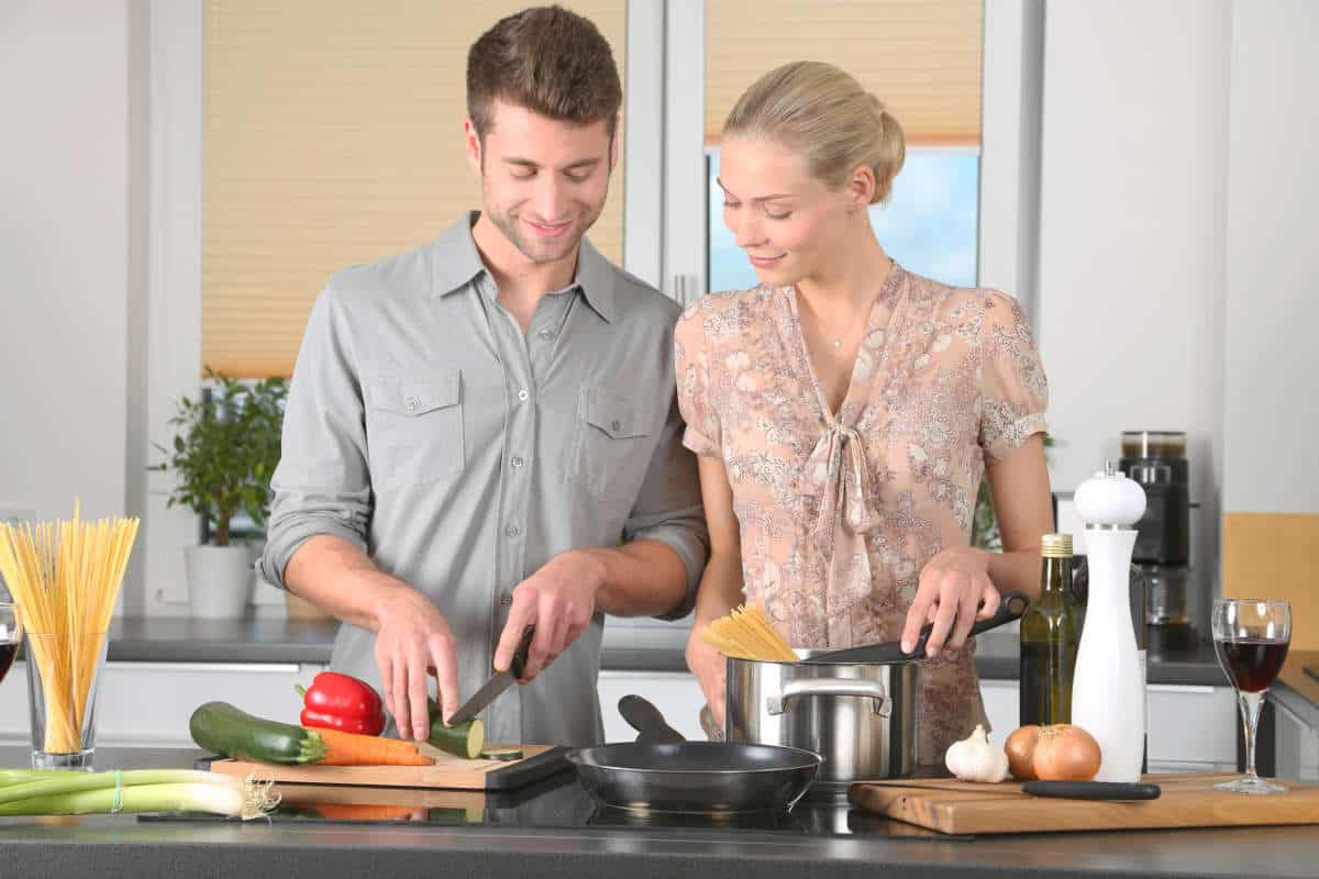 Woman and man in the kitchen cooking   How to Make Alexa Your Sous Chef   alexa skills   alexa sous vide