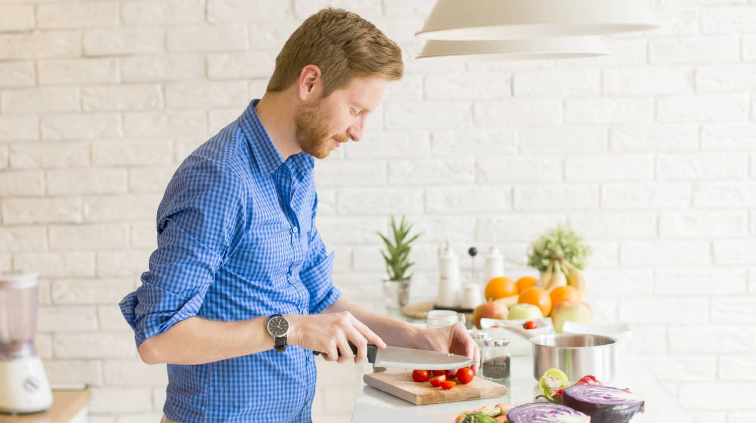 Feature   Young man chopping vegetables   How to Make Alexa Your Sous Chef   sous chef app   alexa sous vide