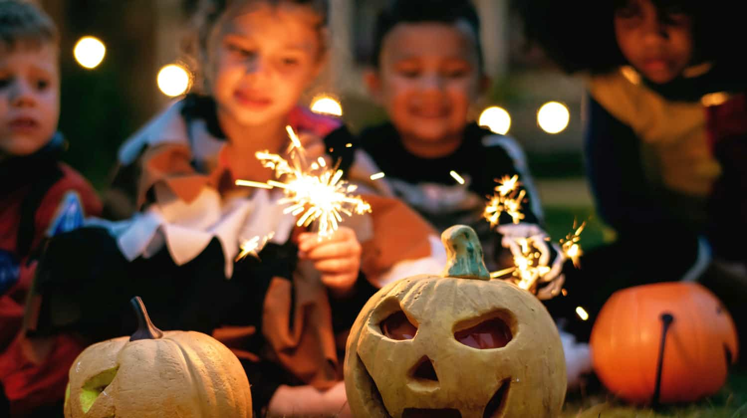 Feature | Children holding firecrackers outdoor | Best Kid Tracker Apps | Track Your Kids While Trick Or Treating
