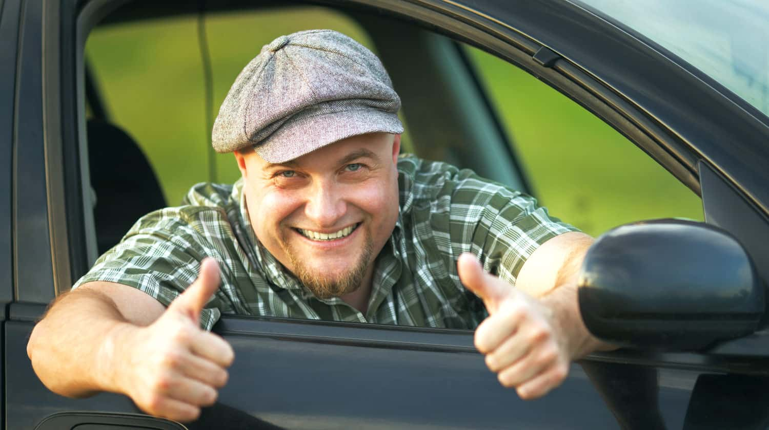 Feature | Happy driver shows that everything is fine | The Best Online Car Buying Sites and Apps