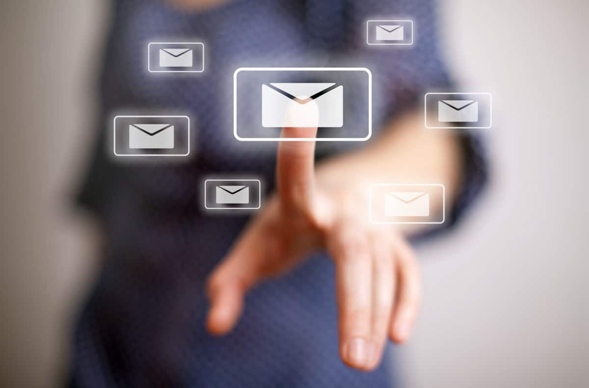 woman hand pressing e-mail sign | What's the Difference: Viruses vs. Malware