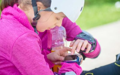 Feature | kid checking the time | Best GPS-Enabled Kids Watches | Child Safety For The Modern Family