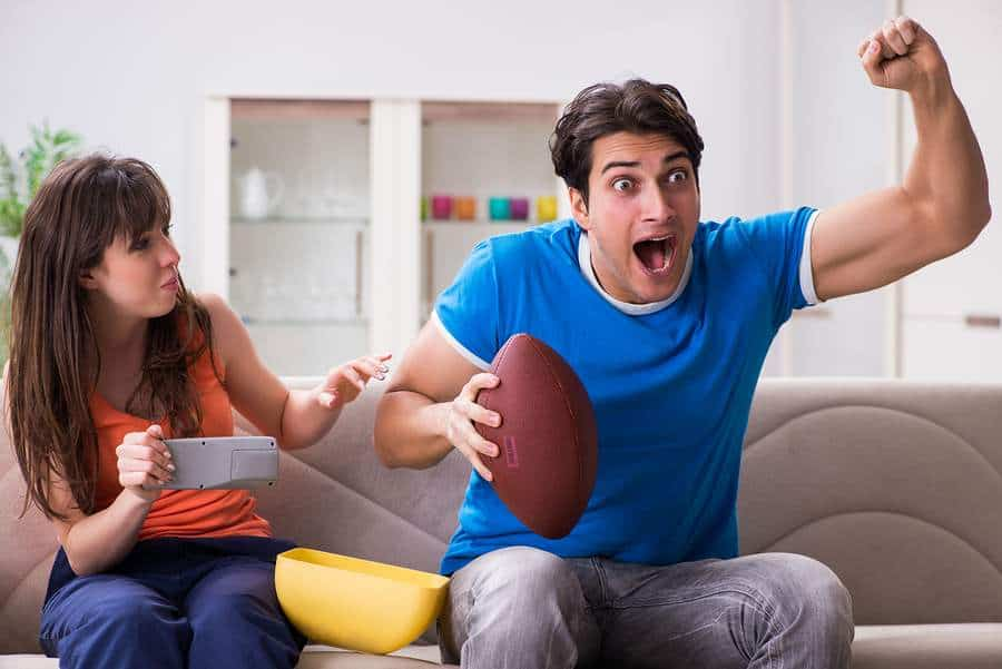 Man and woman watching football