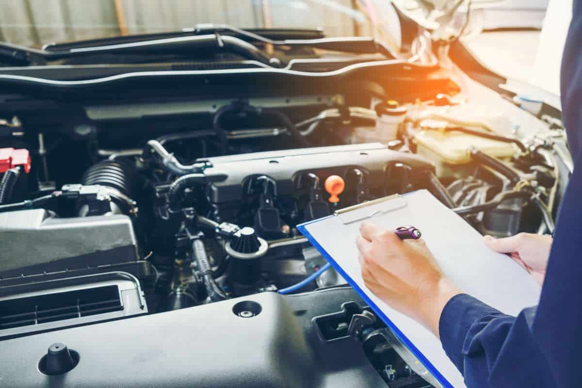 Mechanic holding a clipboard of service order workingAutoTempest Used Car Finder | Overview And FAQs