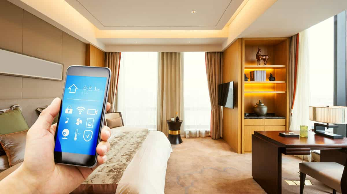 Mobile phone apps in modern luxury bedroom | The Ultimate Smart Home Systems Buying Guide