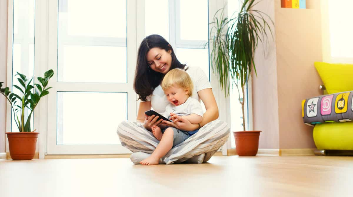 Mother and baby looking | The Ultimate Smart Home Systems Buying Guide