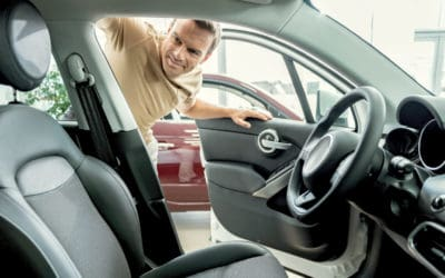 Featured | Smiling man looking car interior | AutoTempest Used Car Finder | Overview And FAQs