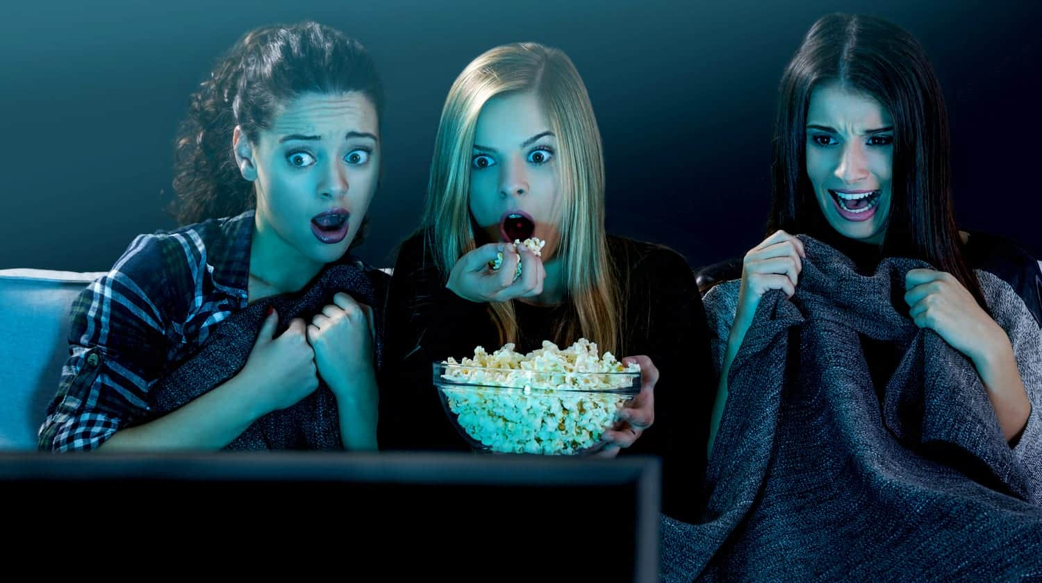 Feature | teenage girls watching horror movie | Best Horror Movies of All Time