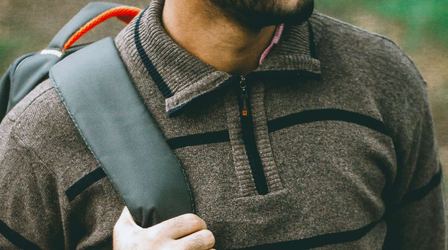 Feature | man wearing backpack | The Mancro Travel Charging Backpack | Amazon Finds
