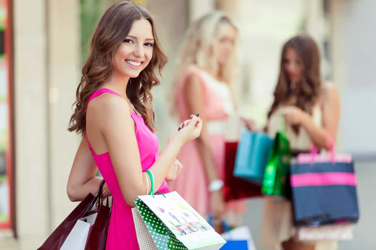 Happy shopping woman | When Shopping in a Store, Prepare Yourself for Long Checkout Lines. Wear Comfortable Clothes and Shoes | Black Friday and Cyber Monday Shopping Survival Tips