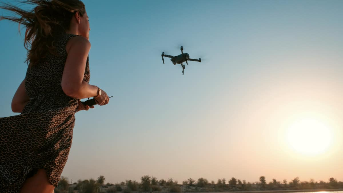 Woman holding remote of drone | Digital Cameras and Drones | The Ultimate Amazon Cyber Monday and Black Friday Shopping List