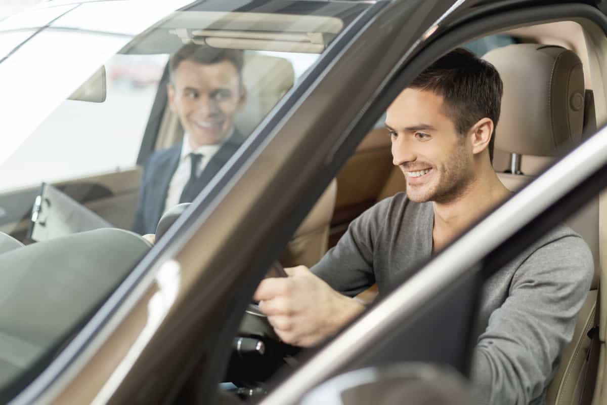 Handsome young man ready to make first test drive | Money-Making Side Hustles | Which One Is Best For You?