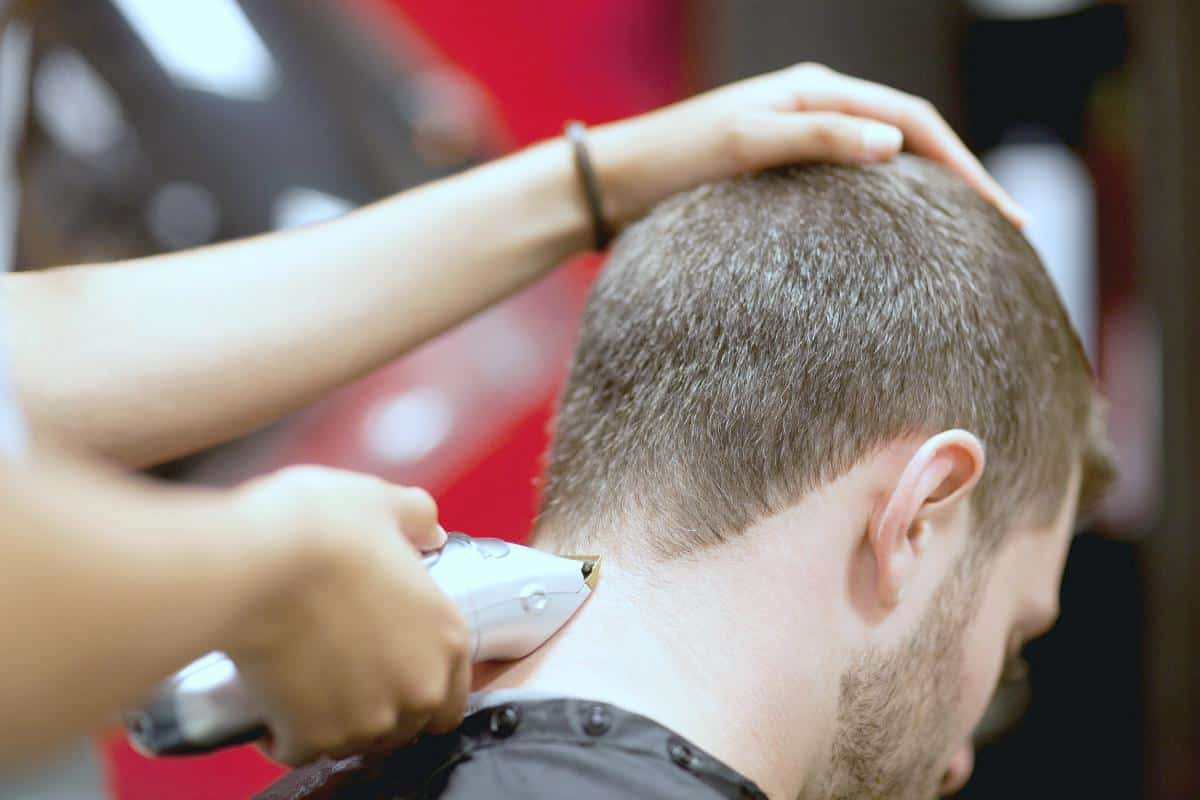 man having hair cut | Unconventional Ways to Save Money