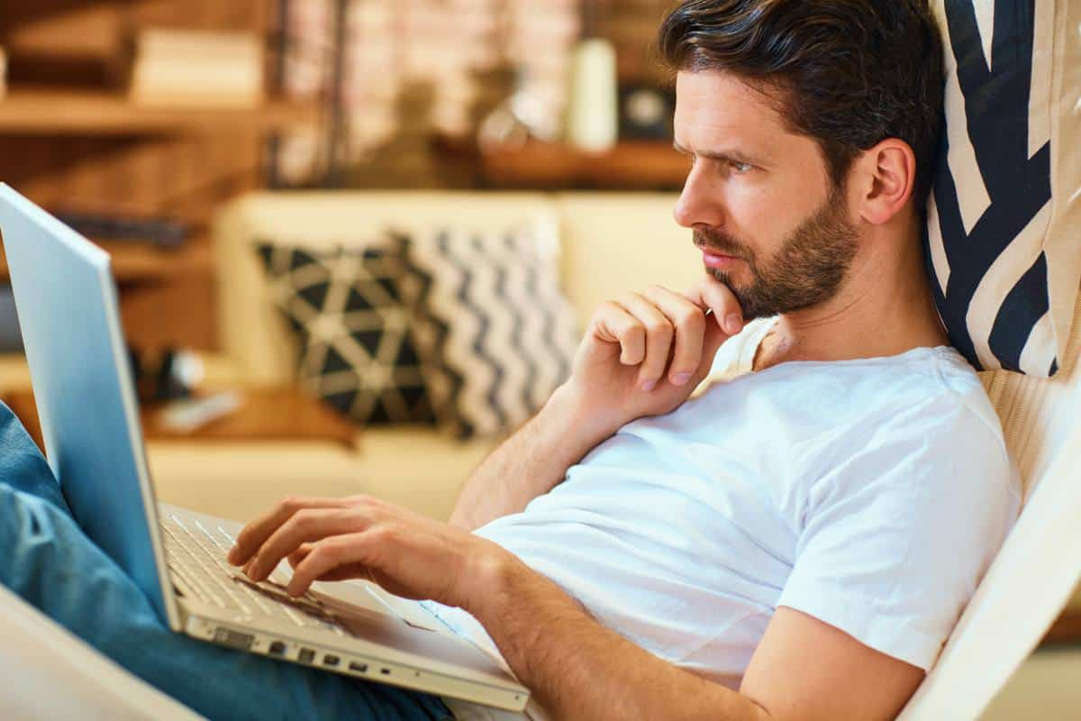 serious man looking at his laptop | Money-Making Side Hustles | Which One Is Best For You?