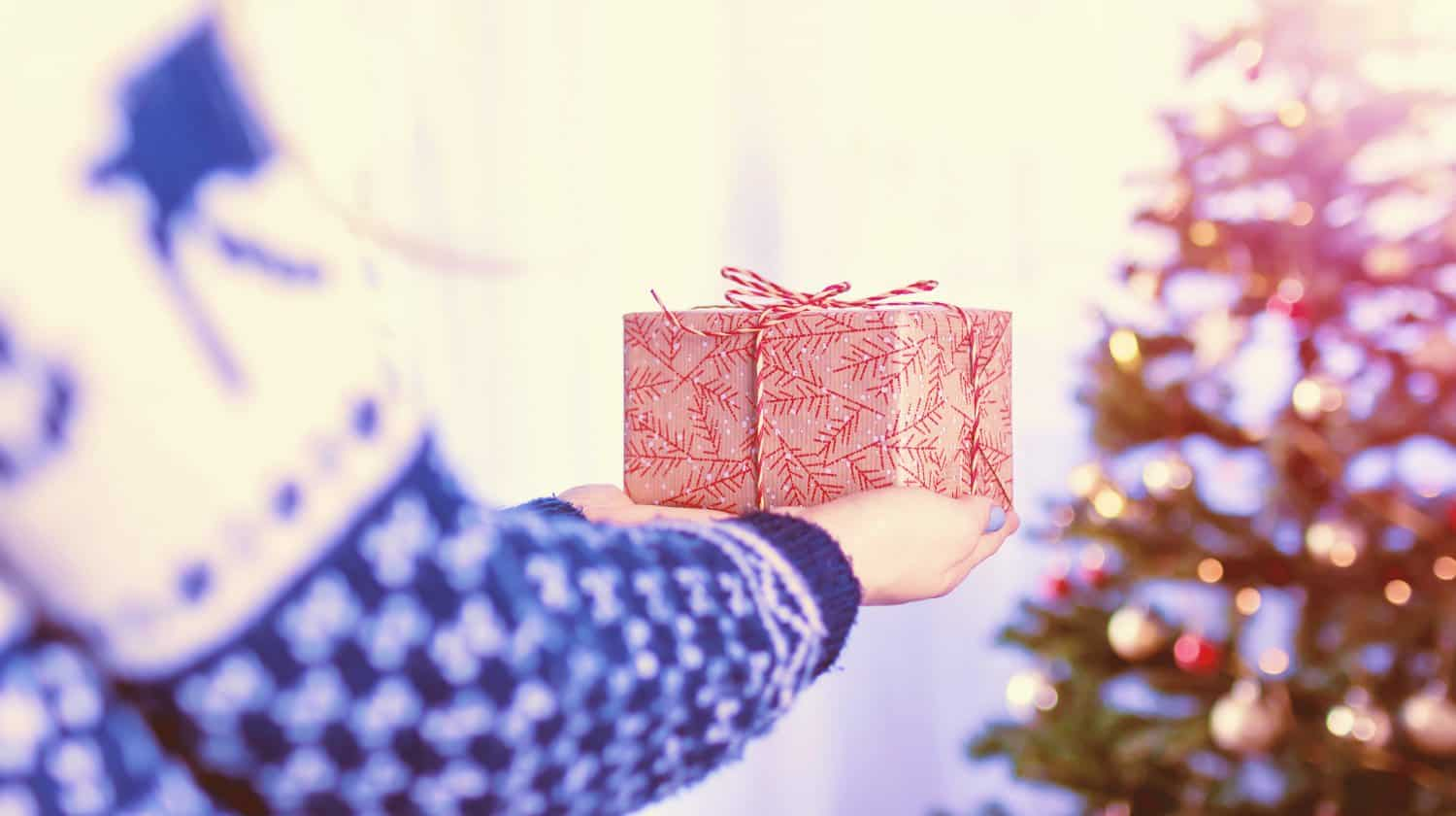 Feature | person holding a gift | Cool Tech Gifts For Gadget Lovers