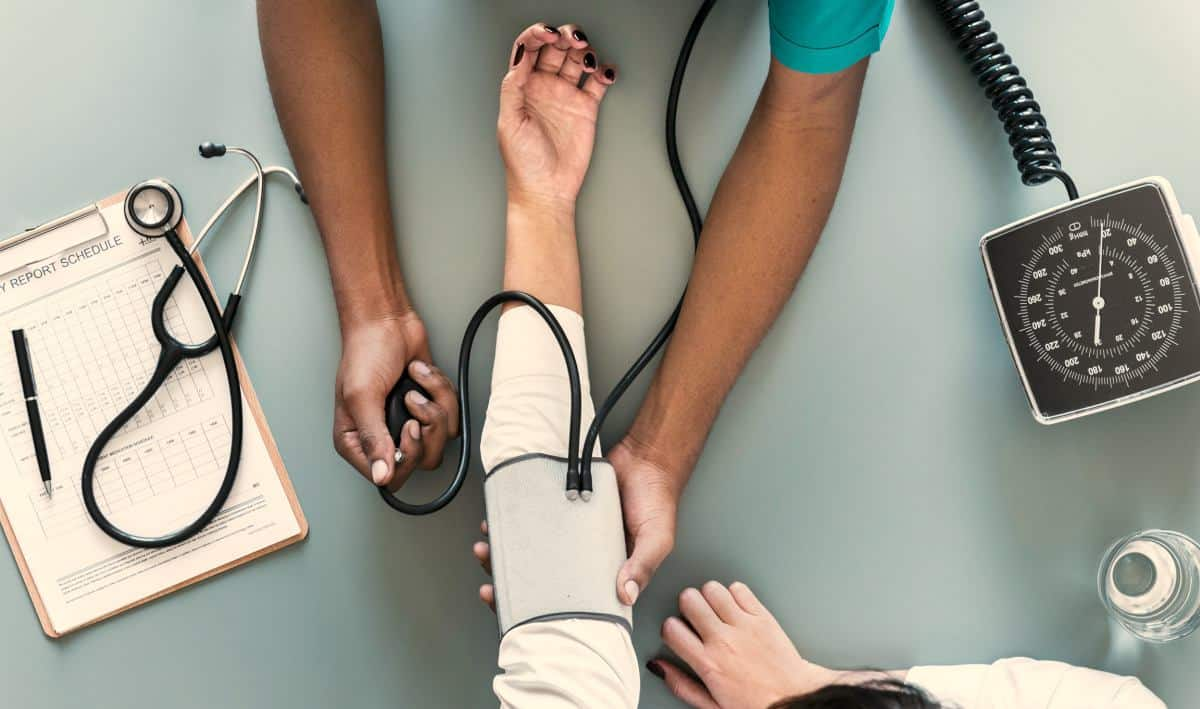 taking blood pressure | Unconventional Ways to Save Money