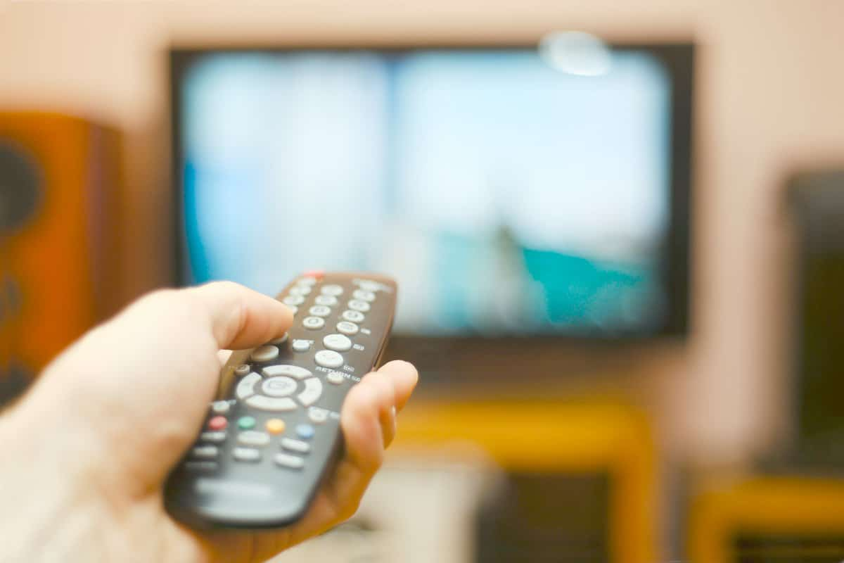 person watching tv | Unconventional Ways to Save Money