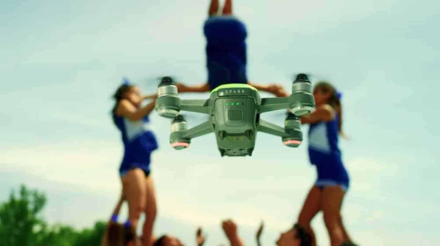 Feature | Flying drone with cheerleader on background | Dji Spark | 7 Most Popular Drone Reviews