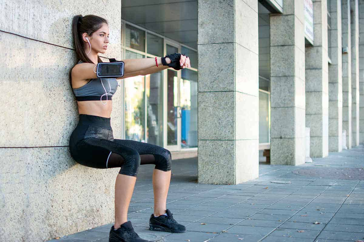 Woman listening to music while doing fitness workout | There's An App For That | Phone Apps For Anything and Everything