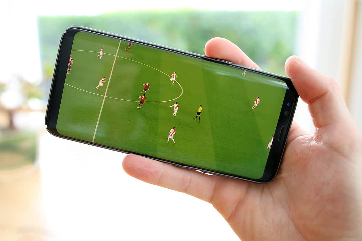 Playing football on mobile phone | There's An App For That | Phone Apps For Anything and Everything