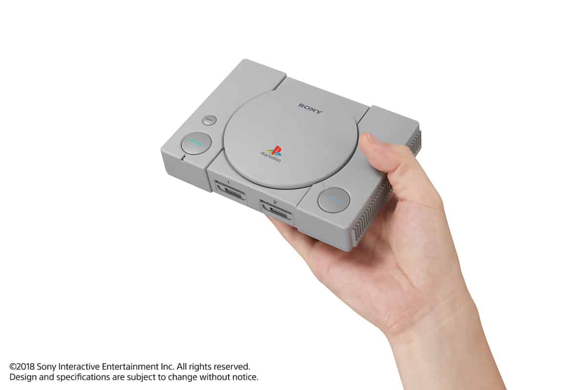 holding PlayStation mini | PlayStation Classic | A First Look At The PlayStation Mini Console
