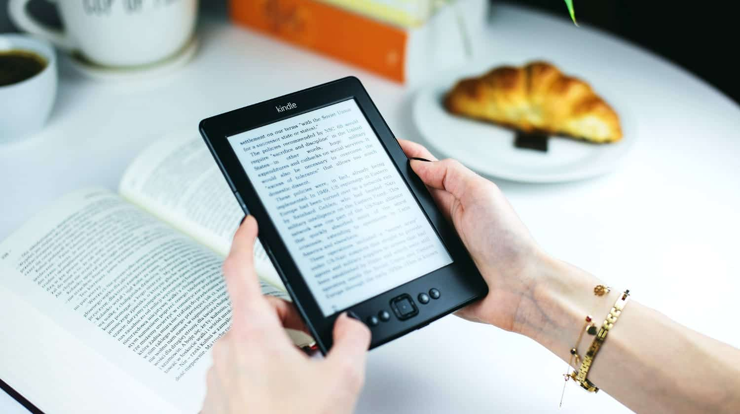 Feature | lady reading on kindle | Amazon's Best Selling Tech Kindle eBooks