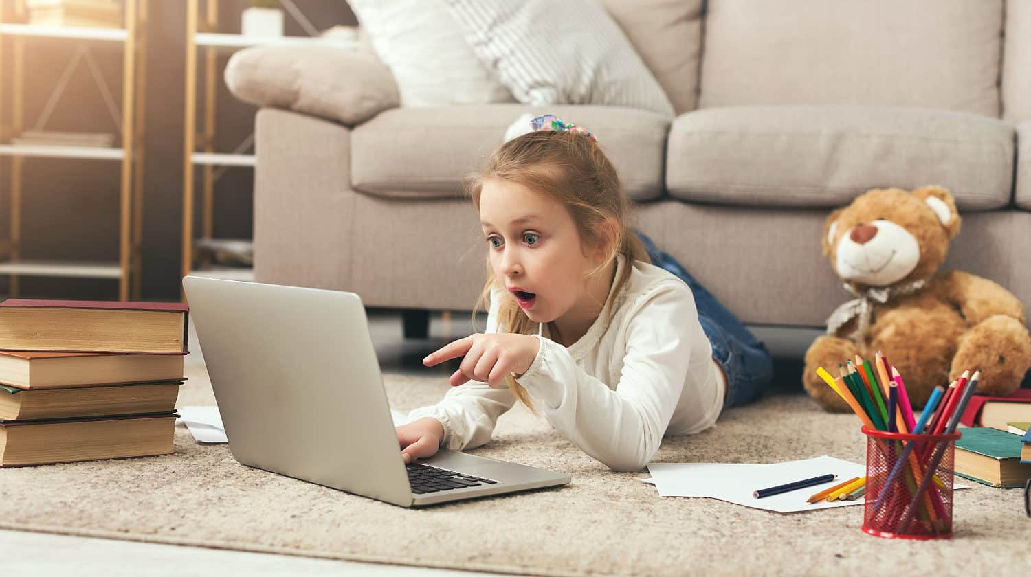 Featured | Shocked little casual girl watching movie | Netflix Viewing History | How To Monitor Viewing Activity Right Now