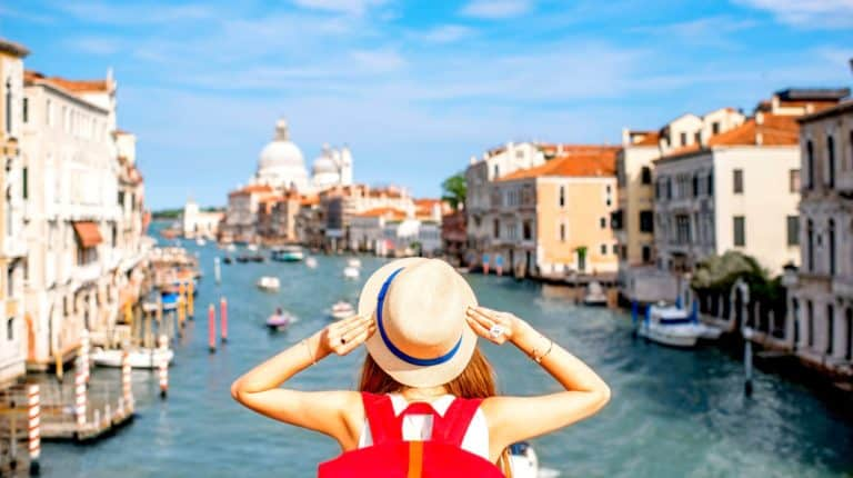 Feature   woman on the grand canal   Awesome Travel Apps That Can Help You Find the Best Vacation Spots