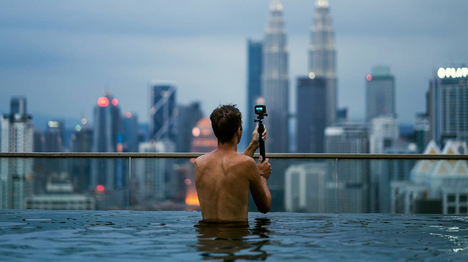 Feature | Man using GoPro in the pool | Top Entertainment Gadgets On Amazon For The Not So Tech-Savvy