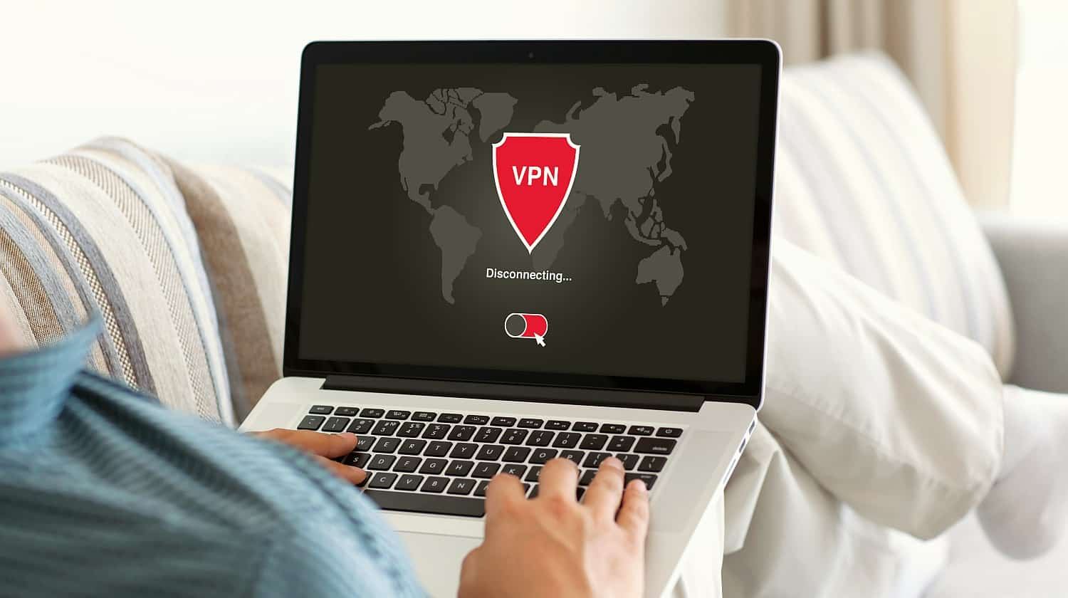 Feature | Man using VPN on his computer | Best VPN Providers