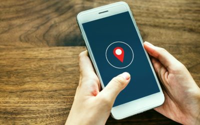 Feature | Holding smartphone showing location | Location Tracking On Smartphones: How Does It Work?