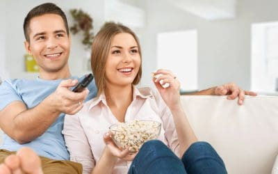 Feature | Couple watching a movie | Chromecast 2 vs Chromecast Ultra: What's The Difference?