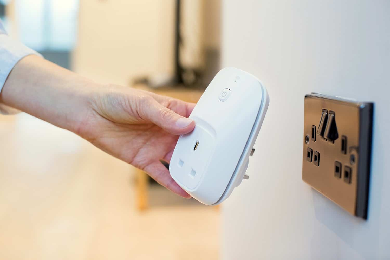 Feature | Woman plugging smart plug | The 10 SMARTEST Smart Plug Uses