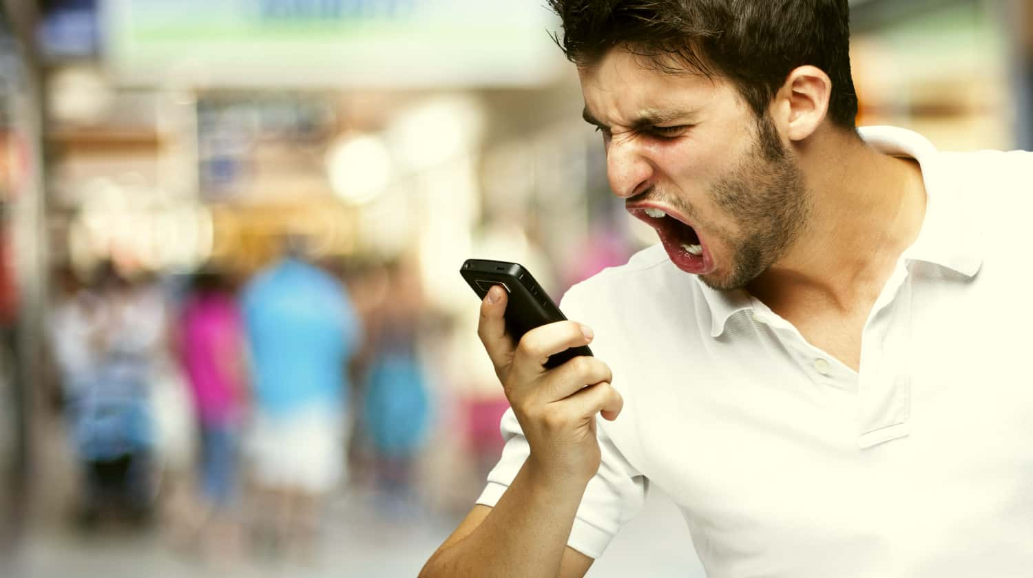Feature | Angry young man shouting | Ways You Are Being Rude With Your Cell Phone | bad cell phone habits