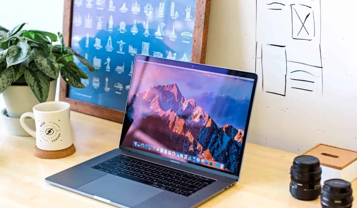 macbook on top of a table | Must-Have Apple Accessories Available on Amazon