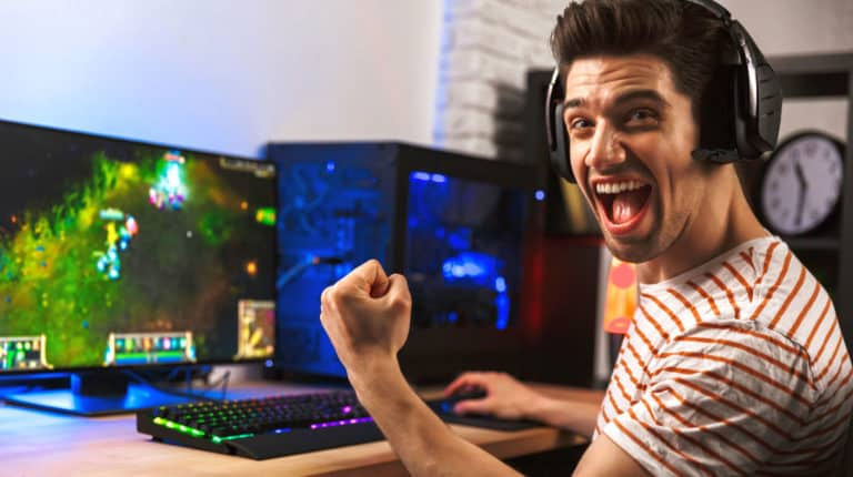 Feature | Portrait ecstatic gamer guy headphones | The Ultimate Guide To PC Games