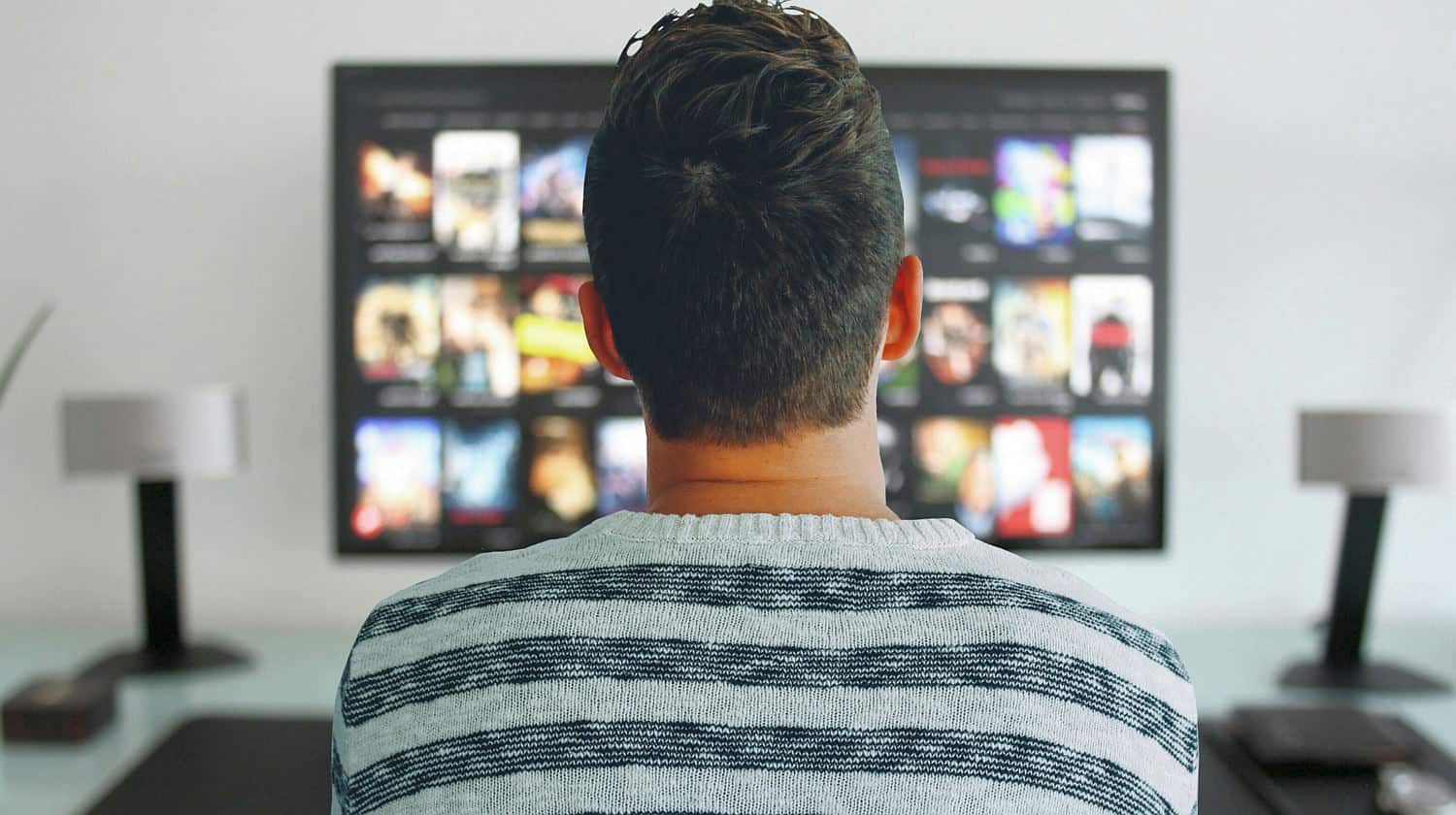 Feature | tv man watching room office | Streaming Devices Face Off: Chromecast VS Fire Stick