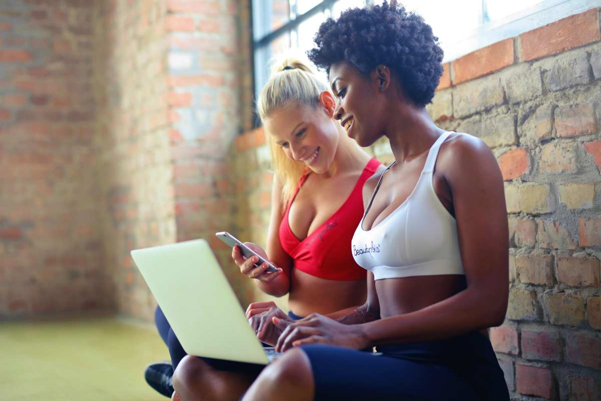 two women wearing sports bra | What Is A Mobile Hotspot? The Pros And Cons Unveiled | wi-fi hotspot | data | phone