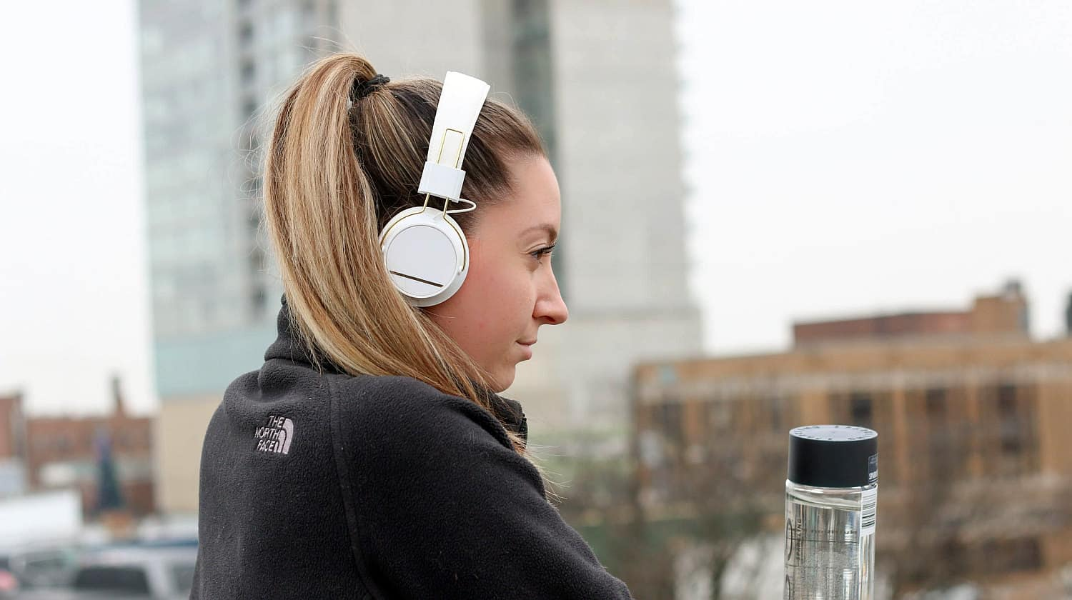 Feature | Woman black black jacket with white headphone | Must-Have Wireless Tech Gadgets That Will Make Your Life Easier | Wireless Technology